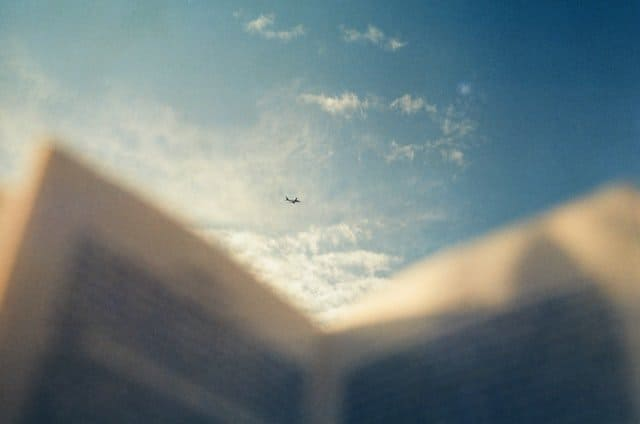 Book and aircraft.